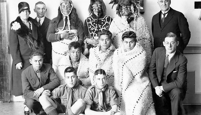 "Alumni Association presentation of totem poles to UBC.<br>Photo credit: <a href=""https://dx.doi.org/10.14288/1.0019521"" target=""_blank"">UBC Archives</a></center>"